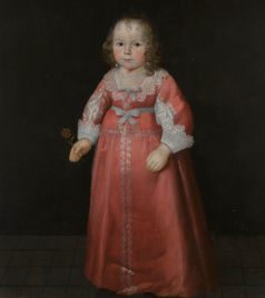 Portrait of a young girl in pink dress with a lace collar and cuffs
